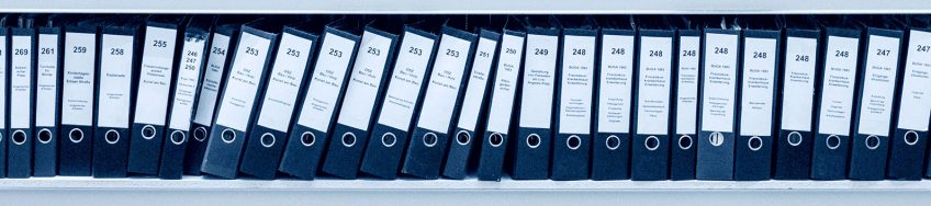 A row of business files on a book shelf